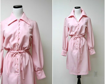 PINK CENTRAL . 1970 vintage long sleeve dress . fits a medium to large
