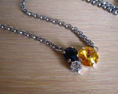 Asymmetric Black & Gold Swarovski Crystal Pendant Necklace on a Rhodium Rolo Chain
