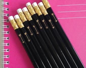 black pencils with gold foil arrow