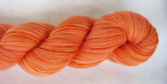 Greatest of Ease Sock Superwash Fingering Handdyed Yarn Color: Peachy Keen