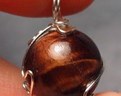 Summon Materia in Silver - Freestyle Silver Wire-Wrapped Red Tiger's Eye Pendant