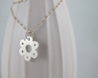 Minimalist flower necklace with sterling silver by Swallow Jewellery