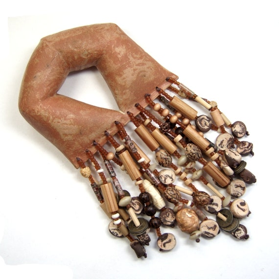 U -Shape Ceremonial Rattle heavily Adorned with Clay, Wood, Horn and Seed Bead Fringe