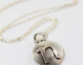 """Small lowercase inital letter """"n"""". Sterling silver disc necklace handmade by Norita Designs"""