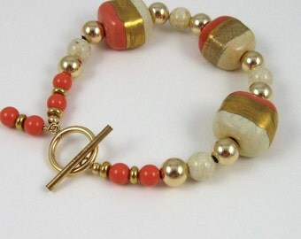 Peaches and Cream Bracelet, gold striped kazuri beads with riverstone japser and coral colored glass pearls