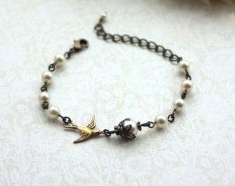 Swallow Bird Bracelet. Ivory Pearls Adjustable Bracelet. Swarovski Cream Pearls, Brass Bird, Vintage Style Bridal Bracelet, Bridesmaids Gift