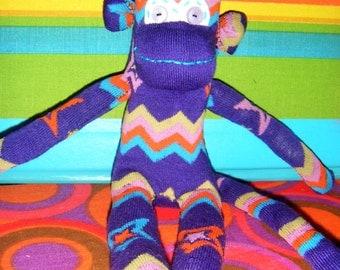 Purple Sock Monkey With Fun Bright Stripes and Stars