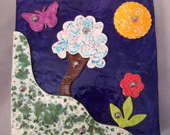 Ceramic Wall Hanging with Raised Elements - Hillside Scene with Grass, Tree, Flower, Sun, Butterfly