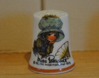 Vintage Miss Petticoat - China thimble - souvenir - Roth International 1978