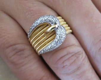 18K two tone diamond Buckle ring.