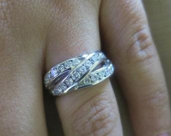 14K White gold round diamond channel ring.