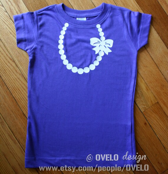 Necklace with Pearls and Bow T-shirt for Girls Pictured in Purple with White Necklace