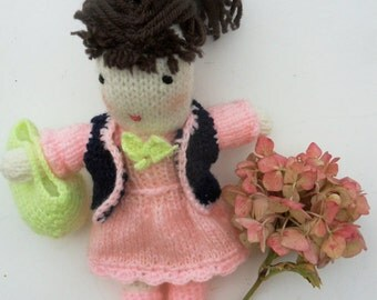 wool doll, knitted doll with a pink dress