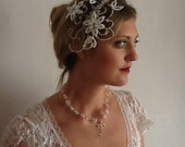 Exquisite bridal fascinator in Swarovski and lace.