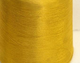 Large spool of gold acetate fiber