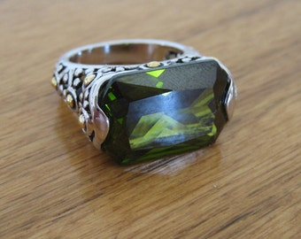 Vintage silver filigree ring.  Size six and a half.  Green glass.