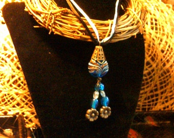 Light blue and black ribbon necklace with blue lampwork bead focal.