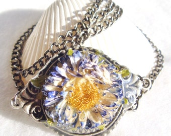 Dried flower necklace, resin covered real flower on gunmetal setting.