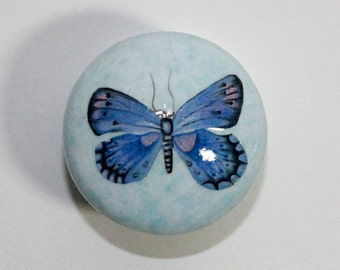 old style dresser knobs with blue butterfly design. handpainted. Transform your furniture.