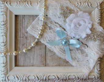 Wedding Garter Set with a White Flower on Comfortable Pale Ivory Lace with Rhinestones