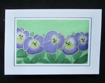 Greetings card, padded, silk, handmade, handpainted, purple pansies on a green background