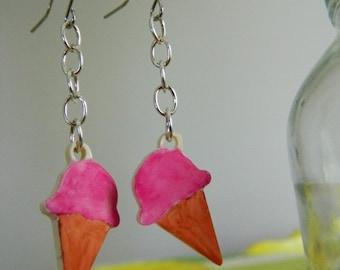 Cute pink dangle ice cream cone earrings.