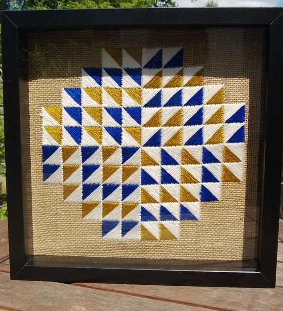 Hand embroidered geometric design, framed