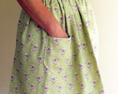 Pretty country style green and cream flowered cotton half apron