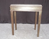 Multiple layers of brown and gold layer this accent table.