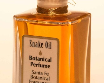 Snake Oil Botanical Perfume & Silk Pouch sultry natural aromatics by Santa Fe Botanical Fragrances create an intensely provocative Floral