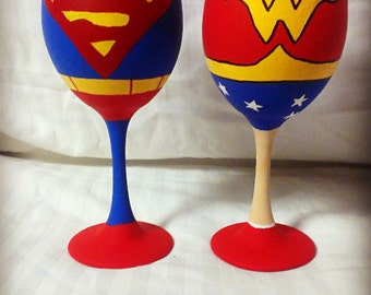 Superman and Wonder Woman inspired hand painted wine glass.