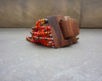 bracelet of  wood and glass pearls