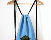 sky blue label URBAN cinch bag