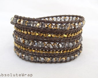 Gold black crystal wrap bracelet with on soft brown polyester cord, gold wrap bracelet