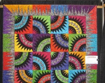 New York Beauty Quilt // Patchwork Quilt // Wall Art // Rainbow Quilt //Batik Quilt // Dancing Batiks // Black/White Batik // PettyQuilt