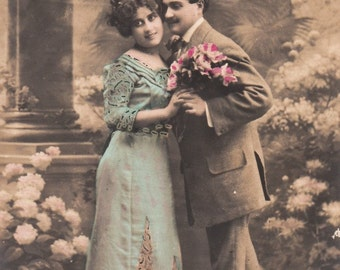 Romantic vintage french lovers postcard . Romantic couple love postcard.