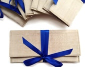 Champagne gold bridesmaid clutches with royal blue.  Custom colors available.