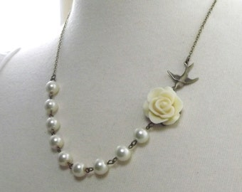 Ivory Flower and Brass Swallow Necklace