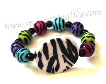 Fun Zebra Stripes all around. Bright colors black white hot pink purple blue and green. Kids thru adult size. All acrylic. Hypoallergenic.
