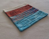 Caribbean Blue and Rust Quilted Patchwork Coffee Coaster or Mug Rug
