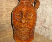 blind whiskey FACE JUG with inscription