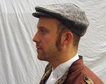 Flat cap in black and white herringbone tweed wool woven by Harris