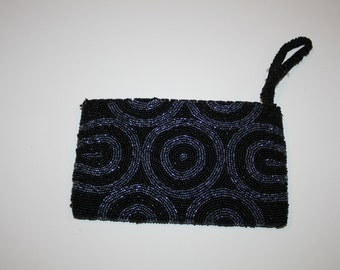 wonderful beaded clutch black and blue circles heavy beading great for parties weddings