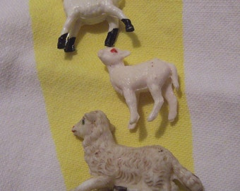 three plastic miniature lambs