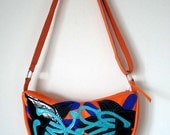 Handmade Crescent Bag in orange leather with black patent and turquoise leather appliqued Lilies