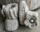 Crochet baby girl boots, in oatmeal, and flower, pearl button center. size 0 to 3 mo. Also in newborn,  0 to 3, 3 to 6, 6 to 9, 9 to 12mo