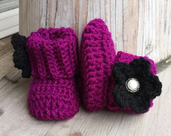 Crochet baby girl boots, in plum with black flower and jewel button. size 0 to 3 mo. .
