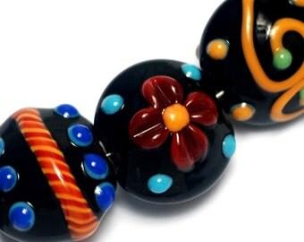 Glass Lampwork Bead Set - Seven Black Based Fiesta Lentil Beads 10201202