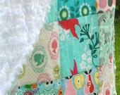 Patchwork baby blanket in blue with soft Minky back