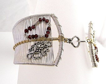 Hand Woven Sterling and Fine Silver with Faceted Garnets Fashion Bracelet